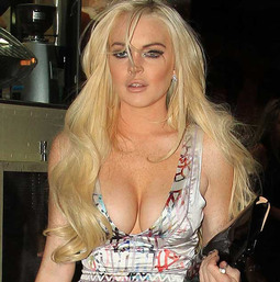Lindsay Lohan Turns Heads at Fashion Week